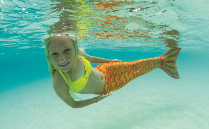 Girl Swimming With Mermaid Tail